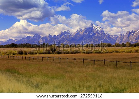 Fence and field near the Tetons, Wyoming, USA. - stock photo