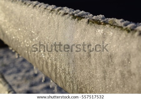 Fence covered in snow and ice