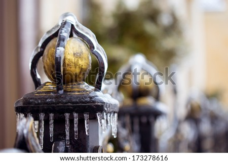fence frozen in ice, unexpected frosts - stock photo