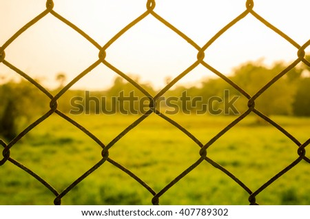 Fence in sunset.