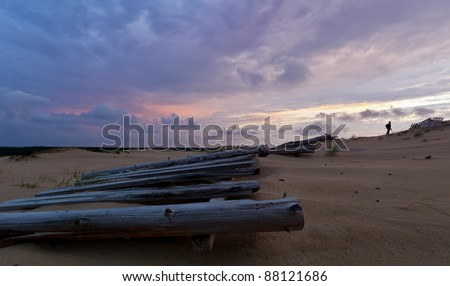 fence in the sand - stock photo