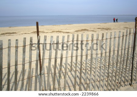 Fence in the sand at the beach.