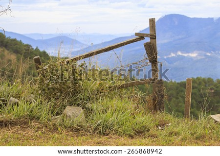 Fence on hill - stock photo