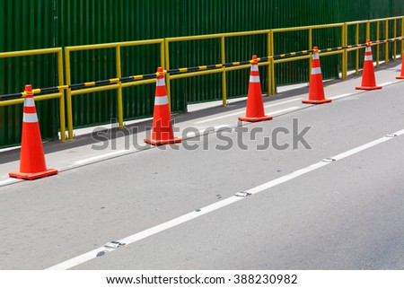 fence on the road on a city street - stock photo