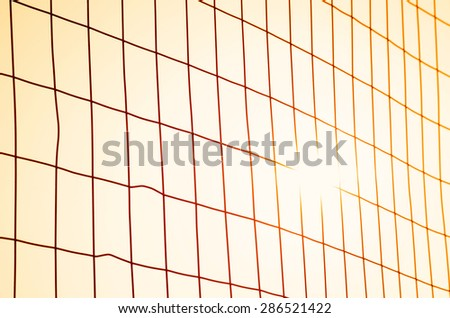fence with orange sky at sunset - stock photo
