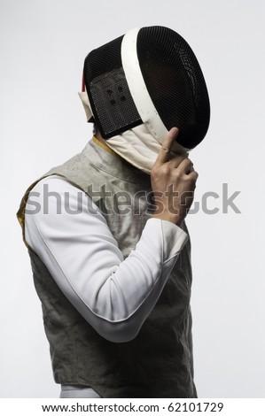 Fencer removing mask on white - stock photo