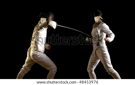 Fencing - a touch!  Man and woman in foils bout, against black - stock photo