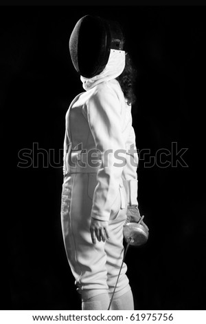 fencing player isolated on black background - stock photo