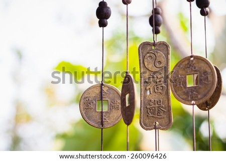 Feng Shui chimes hanged outside the house  for protection and good luck - stock photo