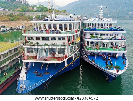 Fengdu Ghost City, CHINA â?? April 14, 2016: Two chinese river cruisers on Yangtze River. Cruise passengers on the Yangtze alone were predicted to hit 1 million this year - stock photo
