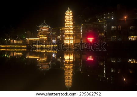 FENGHUANG,CHINA - JUNE 8 : Night view of the old town on June 8, 2015 in Fenghuang,Hunan,China.This ancient town was added to the UNESCO World Heritage Tentative List in 2008 in the Cultural category.