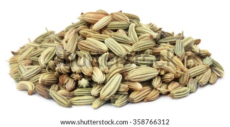 Fennel seeds over white background - stock photo