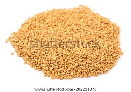 Fenugreek seeds over white background