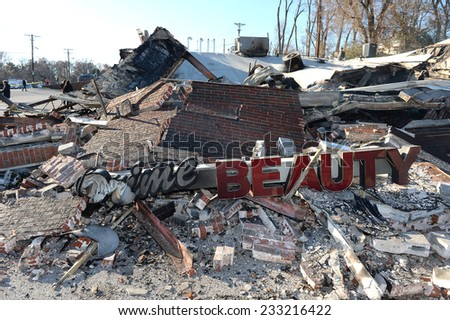 FERGUSON, MO/USA - NOVEMBER 25, 2014: Smoldering remains of Prime Beauty Supply in Ferguson in the aftermath of riots after announcement of Grand Jury decision - stock photo