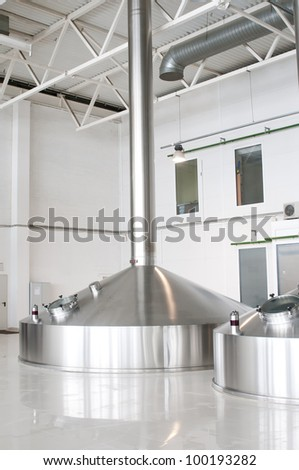 Fermentation vats on brewery - stock photo