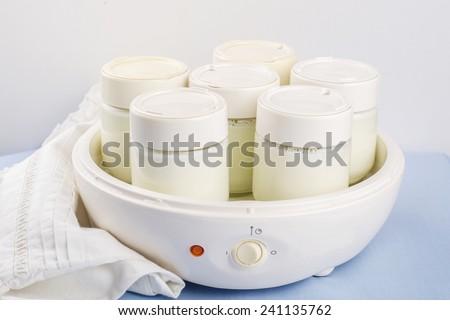Fermented yogurt in yogurt machine - stock photo