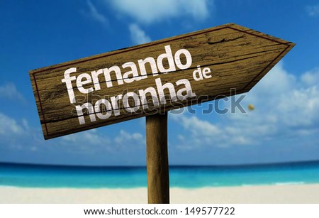 Fernando de Noronha, Brazil wooden sign with a beach on background   - stock photo