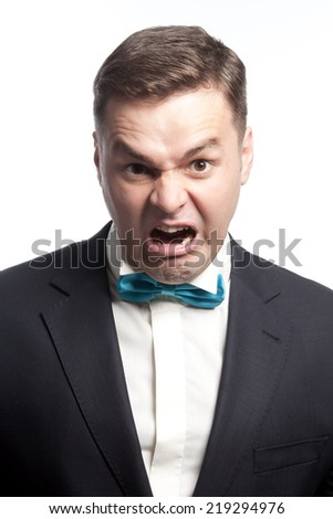 Ferocious guy shows his teeth and scream, isolated - stock photo