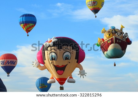 Ferrara, Italia - September 12, 2015: The photo was made at the Ballons Festival at Ferrara on september 12  2015. Brightly colored hot air balloon with a sky blue background - stock photo