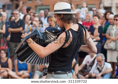 FERRARA, Italy - August 29, 2015: Buskers Festival 2015 in Ferrara, Emilia Romagna, Italy. Busker Festival is a popular event with street artists which is held annually in the center of Ferrara - stock photo