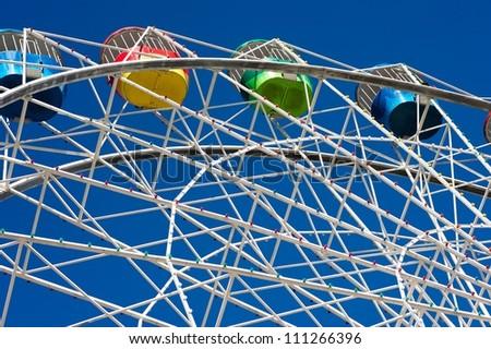 Ferris wheel against a blue sky. - stock photo