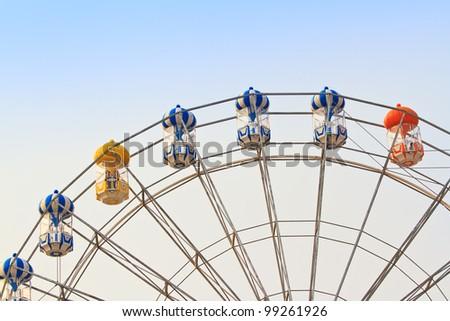 ferris wheel against a blue sky - stock photo