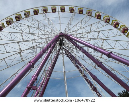 Ferris Wheel Along Geelong Waterfront Against Sky - stock photo