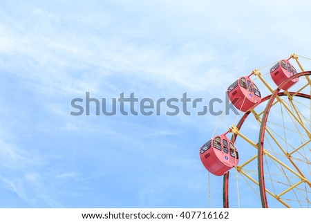 Ferris wheel and blue sky  - stock photo