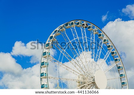Ferris wheel at blue sky in Hong Kong - stock photo
