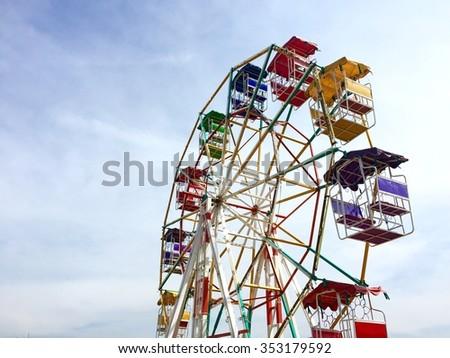 ferris wheel at sunrise with blue sky - stock photo