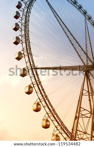 Ferris Wheel at Sunset. - stock photo