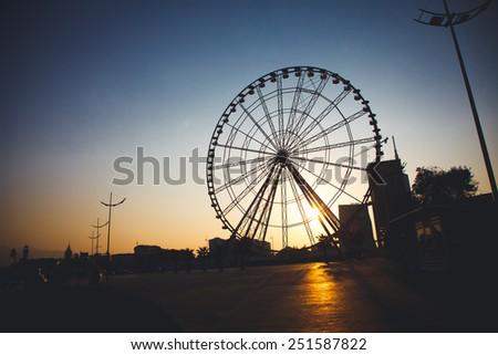 Ferris wheel at sunset, Georgia, Batumi - stock photo