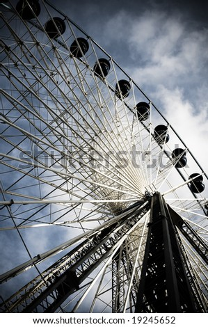 Ferris wheel (dramatic) - stock photo