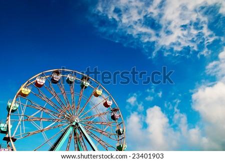 Ferris wheel in blue sky - stock photo