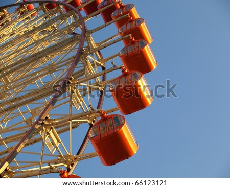 Ferris wheel in  sunset - stock photo
