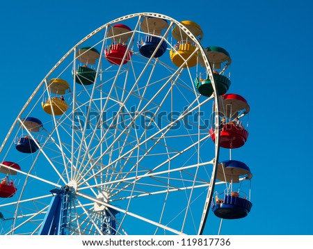 Ferris wheel in the park against blue sky - stock photo