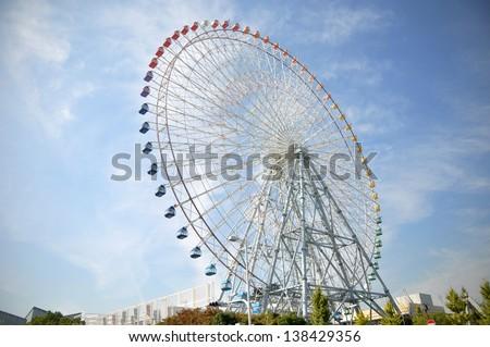 Ferris Wheel near Tempozan Harbor village - Osaka City in Japan - stock photo