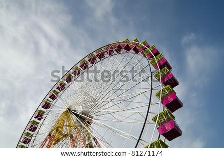 Ferris wheel of fair and amusement park - stock photo