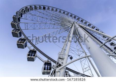 Ferris Wheel on Blue Sky - stock photo