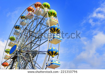 Ferris wheel on the background of blue sky - stock photo