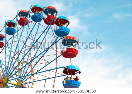 Ferris wheel on the blue sky background - stock photo
