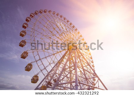 Ferris Wheel Over Blue Sky. Ferris wheel joy sky clouds. Park - stock photo