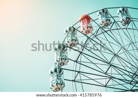 Ferris Wheel Over Blue Sky, pastel green tone  - stock photo