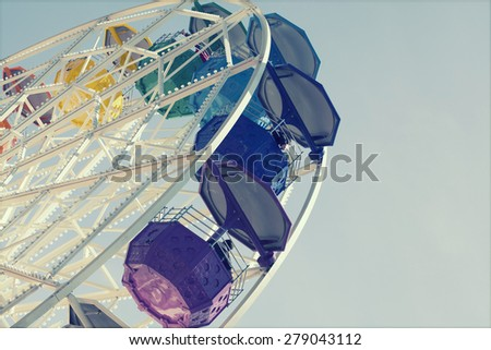 Ferris wheel over blue sky - retro styled photo - stock photo