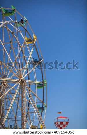 Ferris Wheel Over Blue Sky with copy space - stock photo