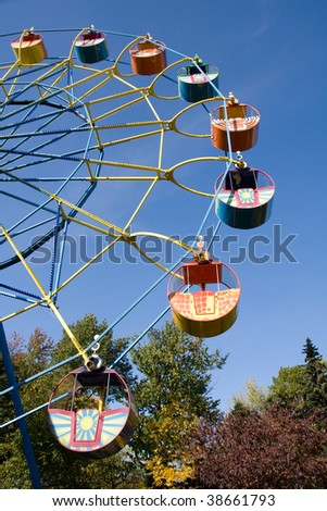 Ferris wheel with blue sky background - stock photo