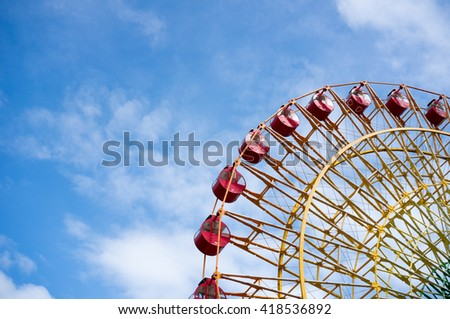 Ferris wheel with sky background - stock photo