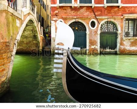 Ferro, iron prow-head of the gondola moored on Grand Canal, Venice, Italy - stock photo