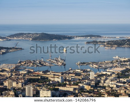 Ferry arriving from Corsica in the harbor of Toulon, right in front of the aircraft carrier Charles de Gaulles - stock photo