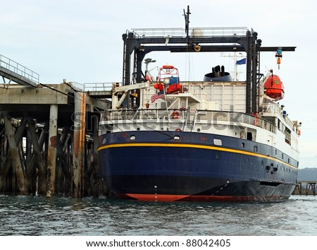 Ferry at the dock - stock photo